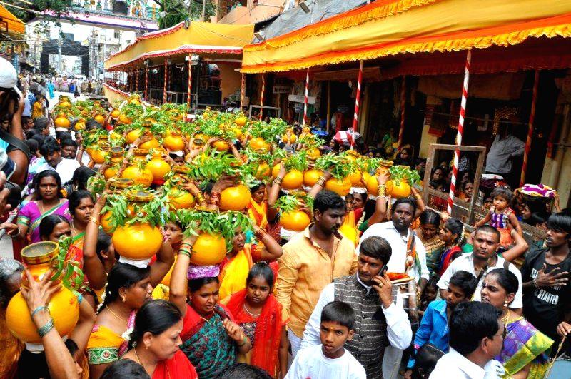 People celebrate `Bonalu festival` in Secunderabad on July 11, 2014.