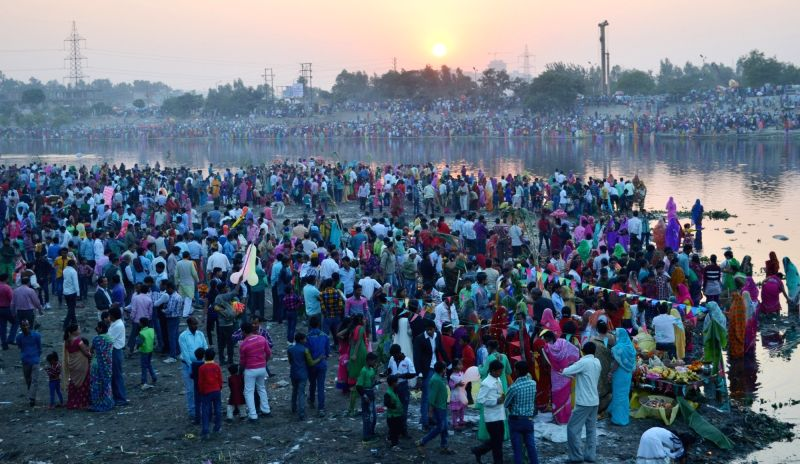 People celebrate Chhath Puja in Ghaziabad on Nov 17, 2015.