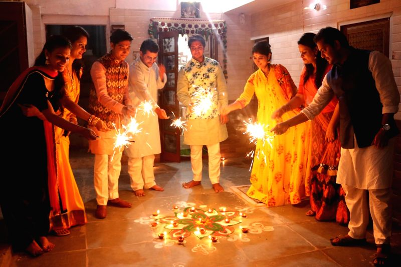 People celebrating diwali with crackers