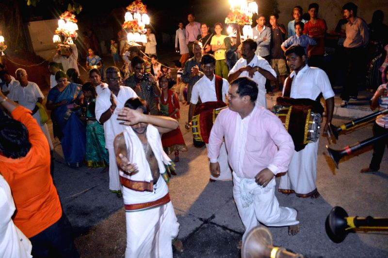 People celebrate during a procession organised on Gsruda Vahanam in Rishikesh on May 16, 2014.