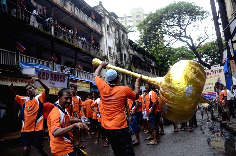 People celebrate Janmashtami in Mumbai on Aug 18, 2014.