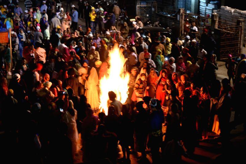 People celebrate Lohri in Nagpur on Jan 13, 2018.