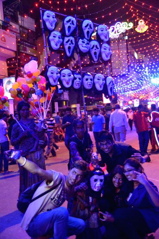 People celebrate on New year's eve in Bengaluru on Dec 31, 2014.