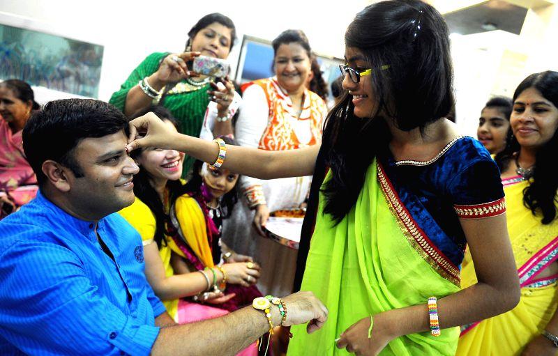 People celebrate `Raksha Bandhan` in Bangalore on Aug 10, 2014.