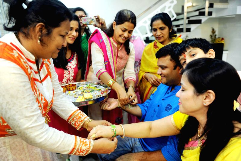 People celebrate `Raksha Bandhan` in Bangalore on Aug 10, 2014.