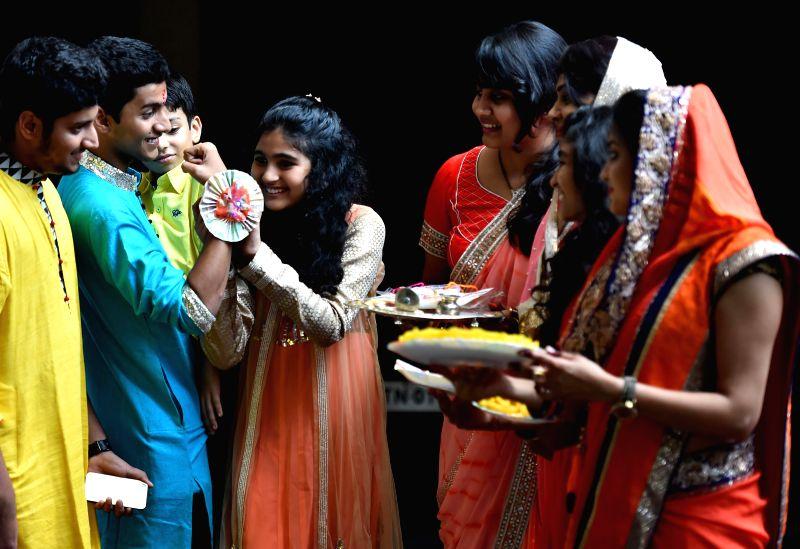 People celebrate `Raksha Bandhan` in Chennai on Aug 10, 2014.