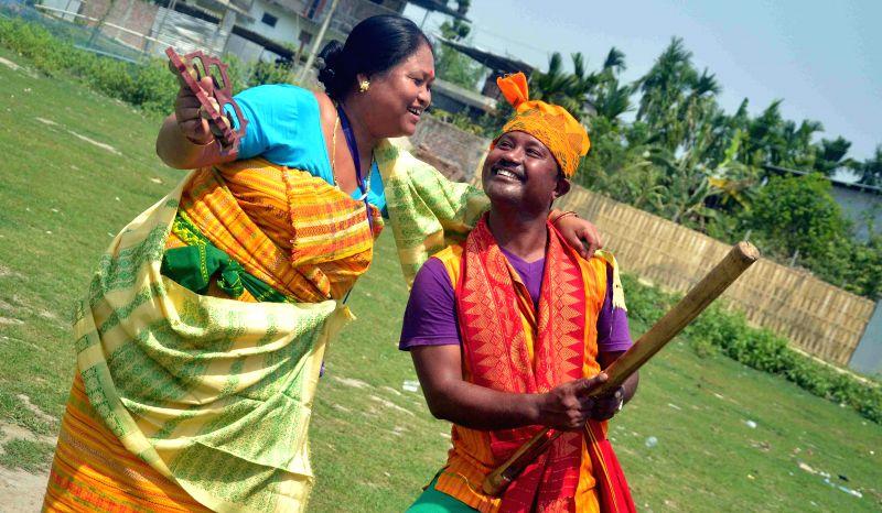 People celebrate Rangjali Bwisagu also known as Bihu in Kokrajhar on April 15, 2014.
