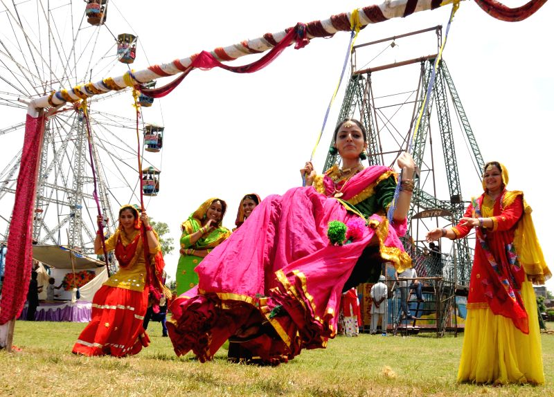 People celebrate Teej festival in Amritsar on Aug 8, 2014.