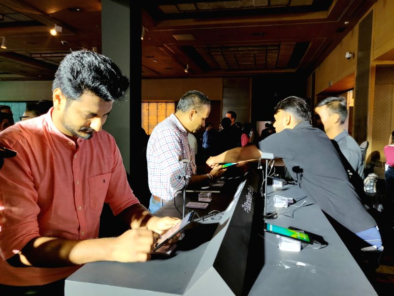 People check out the newly launched BlackBerry Evolve X and BlackBerry Evolve smartphone in New Delhi on Aug 2, 2018.
