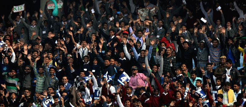 People cheer at Feroz Shah Kotla Stadium during the Fourth and the final test match between India and South Africa in New Delhi on Dec. 3, 2015.