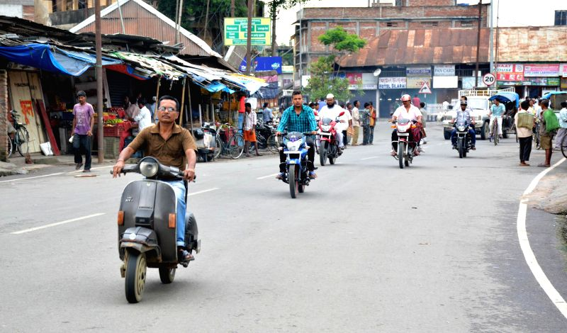 People come out on roads after curfew imposed in Golaghat was relaxed for six hours on Aug 22, 2014.