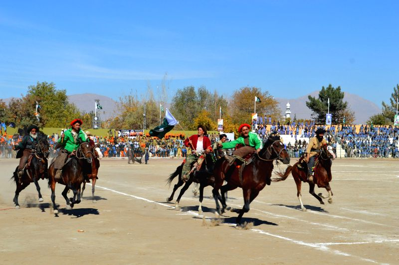 People compete during a horse racing competition at a winter sports gala in southwest Pakistan's Quetta on Nov. 22, 2015.