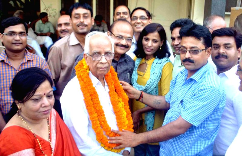 People congratulate former Uttar Pradesh Legislative Assembly Speaker Keshari Nath Tripathi who is set to become West Bengal Governor in Allahabad on July 14, 2014.