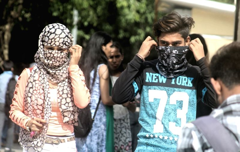 People cover their faces on a hot day in Delhi, on June 5, 2017.