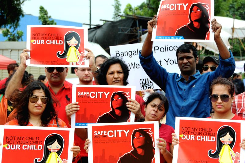 People demonstrate against crime against women in Bangalore on July 20, 2014.