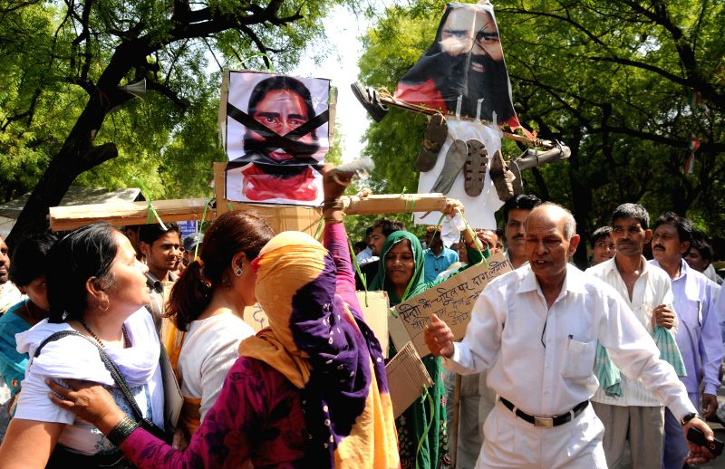 People demonstrate against his anti-dalit remark in New Delhi on April 27, 2014.