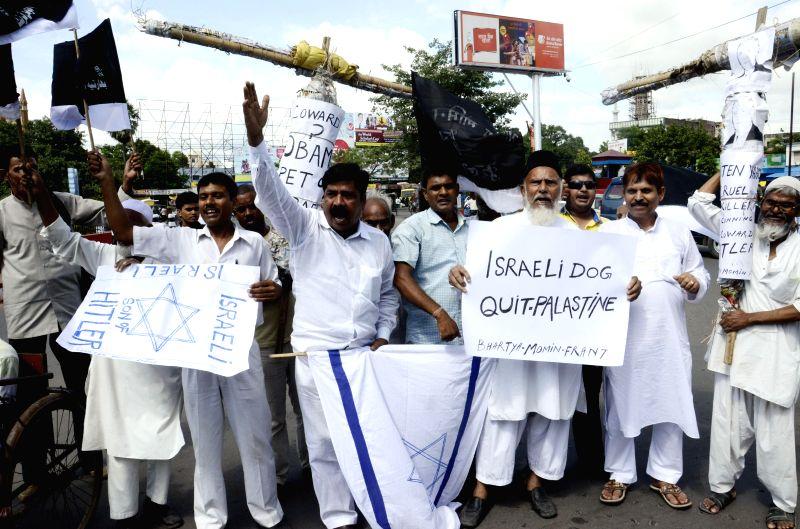 People demonstrate against Israeli attacks on Gaza in Patna on Aug 4, 2014.