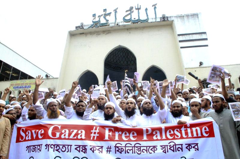 People demonstrate against Israeli attacks on Gaza in front of Baitul Mukarram National Mosque in Dhaka, Bangladesh on Aug 8, 2014.