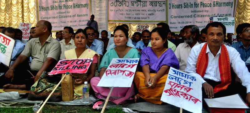 People demonstrate against recent BTAD violence, in Guwahati on May 14, 2014.