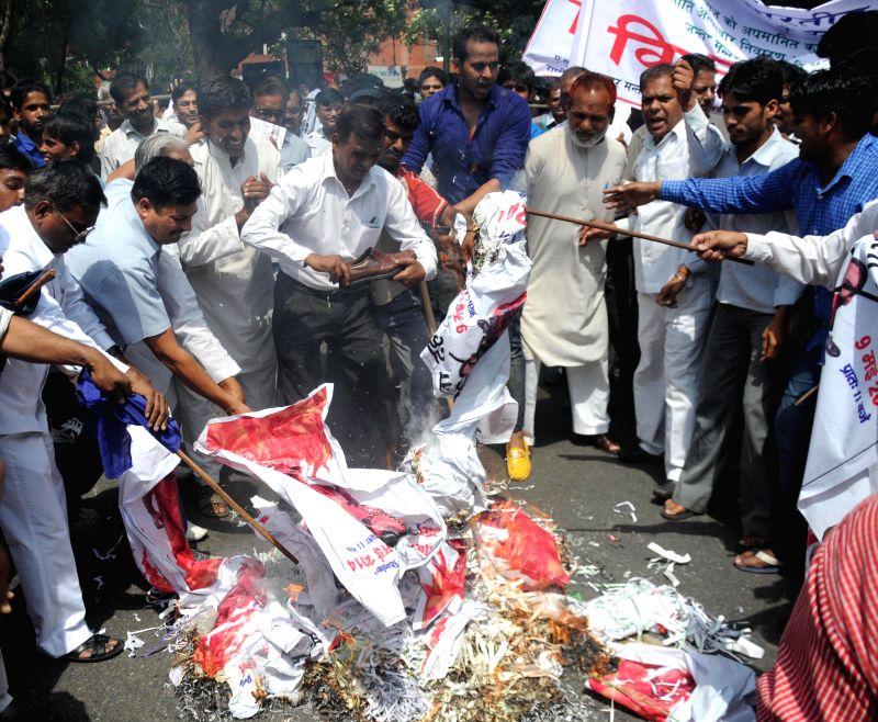 People demonstrate against Yoga guru Ramdev at Jantar Mantar in New Delhi on May 9, 2014.