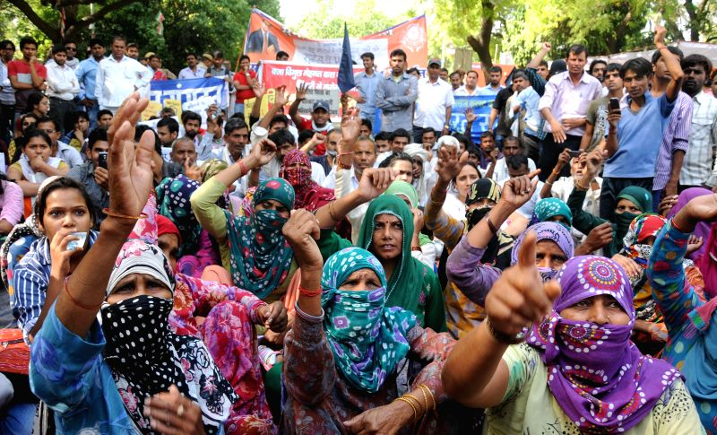 People demonstrate to demand prompt police action in rape cases at Jantar Mantar in New Delhi on April 27, 2014.