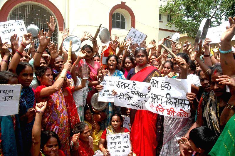 People demonstrate to demand regular supply of subsidised kerosene in Patna on June 24, 2014.