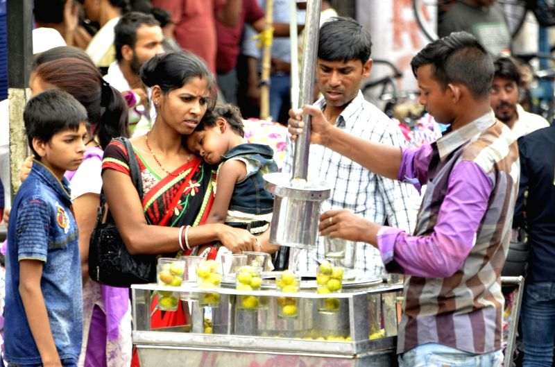 People drink lemonade on a hot day in Ranchi on June 5, 2017.