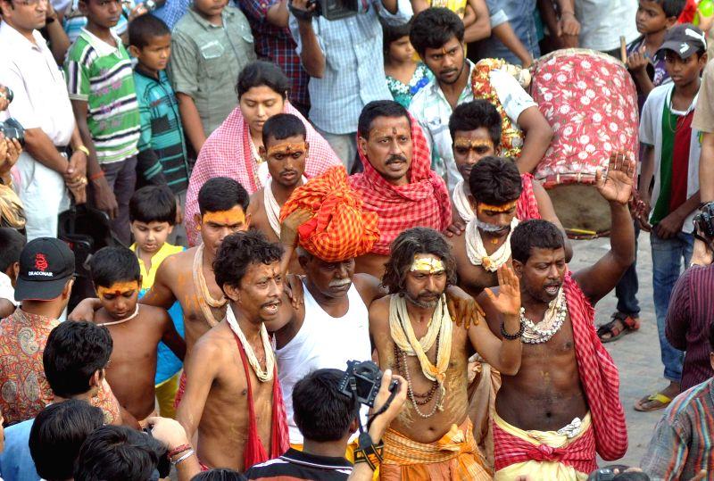 People during  'Charak' celebrations in Kolkata on April 14, 2014.