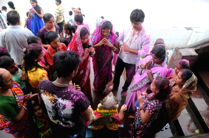 People during immersions of Ganesh idol on the banks of Hooghly river in Kolkata on Aug 31, 2014.