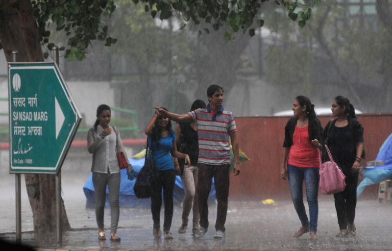 People enjoy rains in New Delhi on Aug 28, 2014.