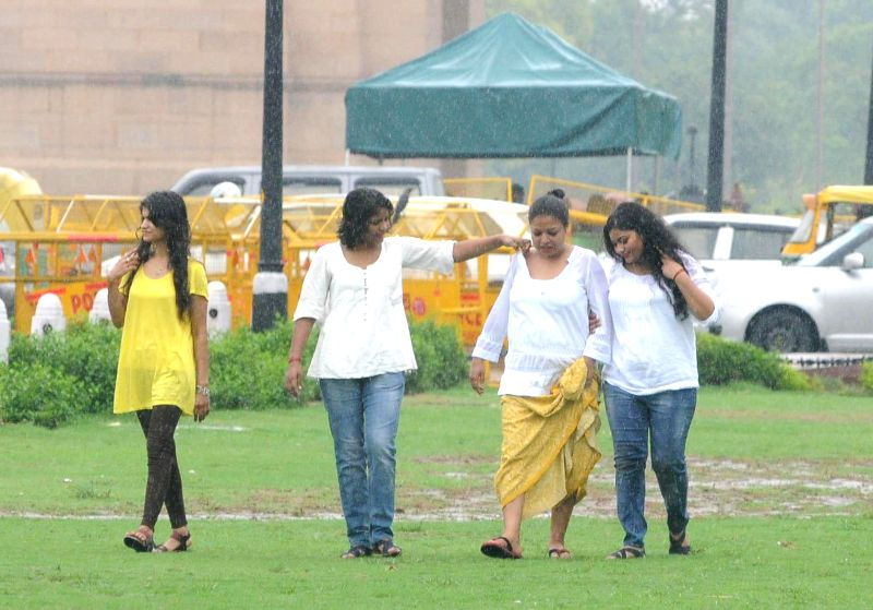 People enjoy rains in New Delhi on July 18, 2014.