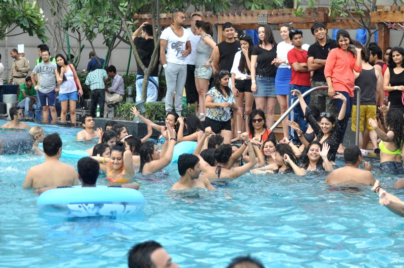 People enjoy themselves during The Woods Party, hosted by Papa CJ at India Fiesta Latina in New Delhi on April 13, 2014.