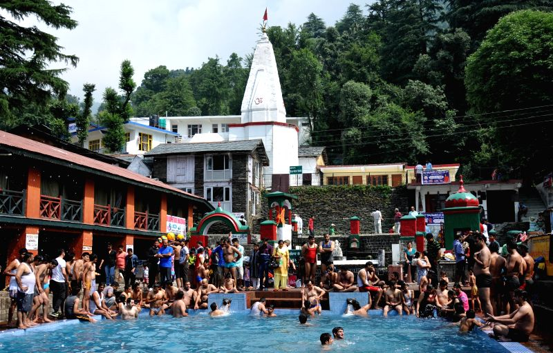 People enjoy themselves in Bhagsu Naag pool in Himachal Pradesh's McLeodganj  on June 29, 2014.