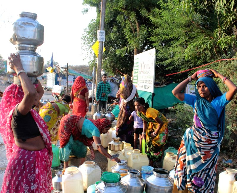 People fill water due to water shortage in Bhopal, on May 28, 2016.