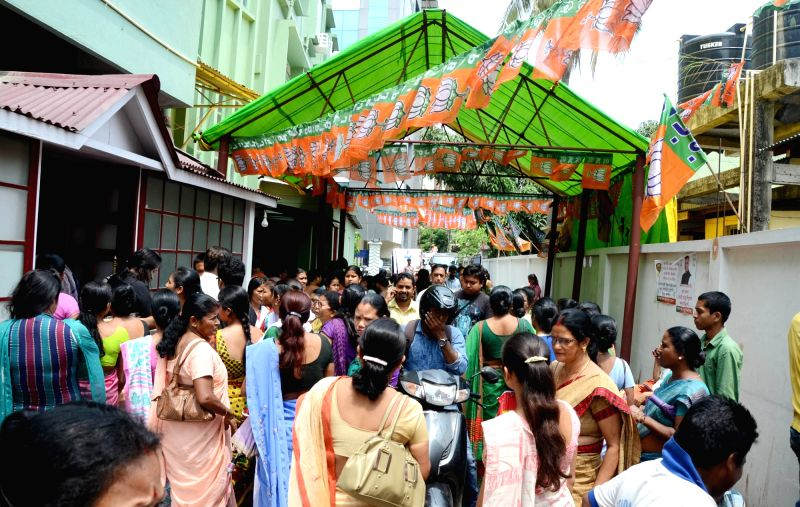 People gather at BJP campaign office to check their names on the voters' list ahead of the second phase of Assam Assembly election scheduled to be held on 11th April; in Guwahati on April ...