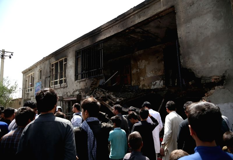 : People gather at the site of a suicide attack in Kabul, capital of Afghanistan, July 26, 2018. At least one Afghan civilian and four intelligence officers were ...