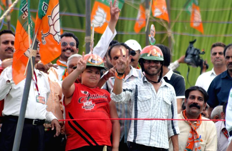 People gather during BJP Prime Ministerial candidate and Gujarat Chief Minister Narendra Modi's rally in Pathankot of Punjab on April 25, 2014.
