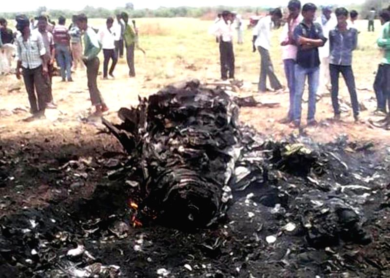 People gather near the site where an IAF airplane crashed in Bibar village, some 70 kilometres west of Bhuj town in western Kuch on August 1, 2014.