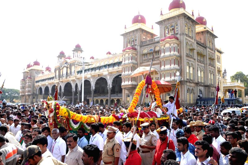 People gather outside Mysore Palace where the mortal remains of Mysore scion Srikantadatta Narasimharaja Wodeyar was kept in Mysore on Dec.11, 2013. Wodeyar died 10th Dec due to a heart attack.