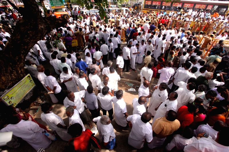 People gather outside the Kauvery Hospital where DMK chief M. Karunanidhi is admitted in the hospital in Chennai on July 30, 2018.