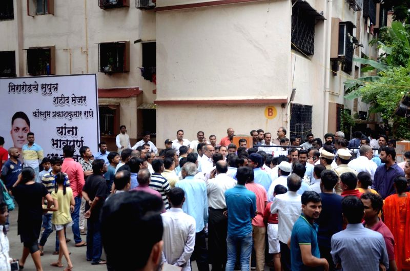 People gather outside the residence of Major Kaustubh P. Rane, who was killed in Tuesday's encounter with terrorists near the Line of Control (LoC) in Jammu and Kashmir's Bandipura; ahead of ...