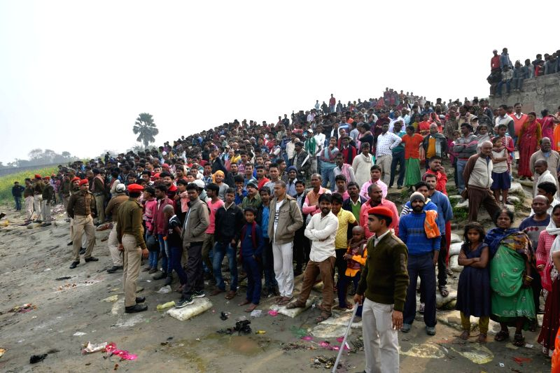 People gather to know the fate of passengers of the boat which capsized near Mastana ghat in the Ganga river at Fatuha of Bihar's Patna district on Jan 31, 2018.