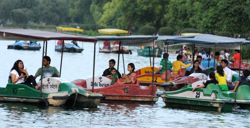 People go for boating at Boat Club near India Gate to beat the heat in New Delhi on May 18, 2014.
