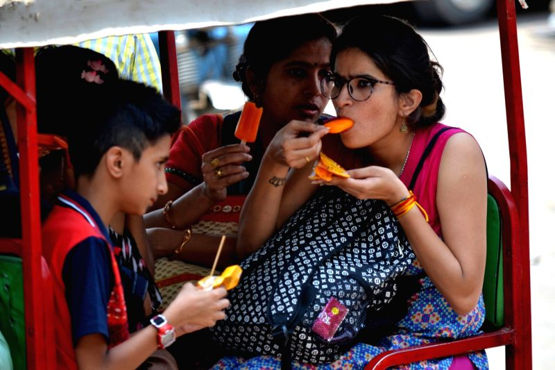 People have ice creams to cool themselves on a hot day in Varanasi, on May 8, 2016.