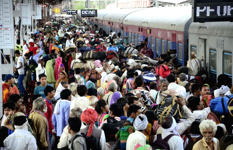 People headed for Ujjain to participate in Simhastha Kumbh Mela throng Bhopal railway station on May 19, 2016. The Kumbh Mela concludes on May 21.