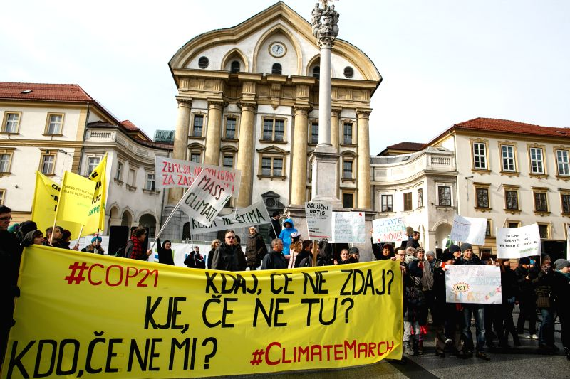 """People hold a banner reading """"If not now, when? If not here, where? If not us, who?"""" during the People's Climate March in Ljubljana, Slovenia, Nov. 29, ..."""
