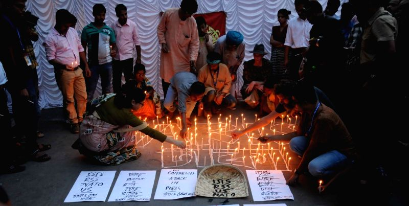 People hold a candle light protest against the terror attack in Paris and murder of blogger in Bangladesh in front of Academy of Fine Arts in Kolkata on Nov 15, 2015.