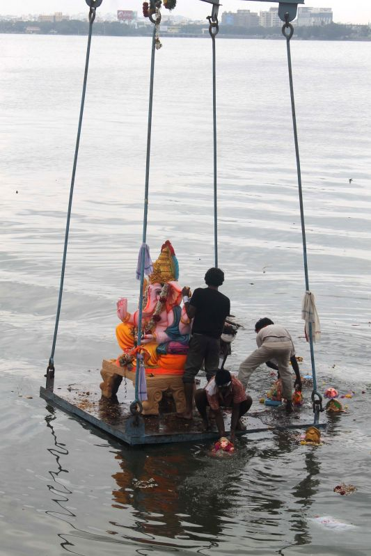People immerse  Ganesh idols at Hussain Sagar after Ganesh Chaturthi in Hyderabad  on Aug 31, 2014.