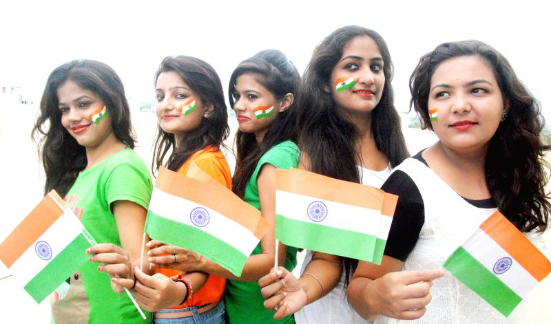 People in celebration mood on the eve of Independence Day in Bhopal on Aug 14, 2014.
