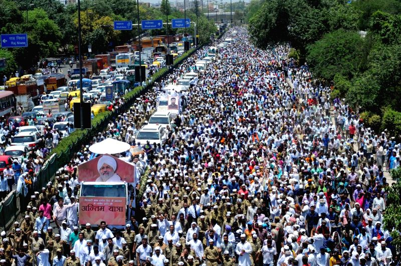 People in large numbers participate in the funeral procession of  Sant Nirankari Mission head Baba Hardev Singh who was killed in a road accident in Canada on May 18, 2016. - Hardev Singh